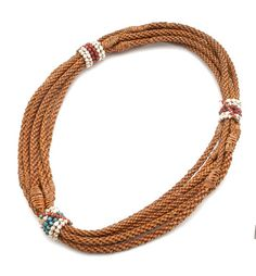 Africa | Necklace ~ 'nthlankana' ~ from the Bahloubi people of Lesotho | 20th century | Glass beads and vegetable fiber