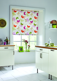 The simple addition of new blinds can really brighten a room - add a dash of colour to your kitchen with bespoke blinds by Blinds Boutique #interiordesign #bespokeblinds #blinds