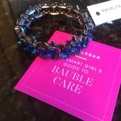 💙NWT Bauble Bar blue crystal bracelet💙 Brand new with tags...royal blue crystal and black spiked bracelet from Bauble Bar. Stretches on and off so it will fit most wrists. Brings a great pop of color to any outfit. From a pet and smoke free home.🚫NO TRADES🚫 Bauble Bar Jewelry Bracelets