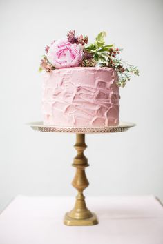 A rose-colored cake with a luscious peony topper.