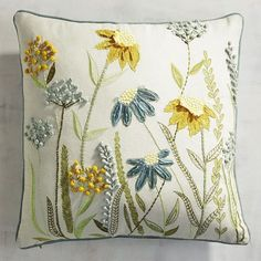 No meadow in your ZIP code? No worries. We& gathered freshly picked wildflowers to create a pretty pastoral focal point for your sofa or accent chair. The cotton cover features embroidered and appliqued blooms in soothing blues, greens and yellows. Cushion Embroidery, Crewel Embroidery, Hand Embroidery Designs, Ribbon Embroidery, Embroidery Patterns, Embroidery Supplies, Floral Pillows, Decorative Pillows, Diy Cushion