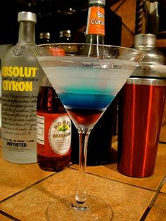 Layer grenadine, blue curaçao and flavored vodka for a red, white and blue martini. Mr. & Mrs. P: All American Martini