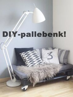 i think this says DIY pallet bed... who cares, i want that lamp!