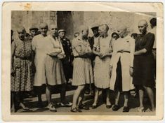 Women accused of collaborating with the Nazis are publicly humiliated by having their heads forcibly shaved after the war in either France or Belgium.