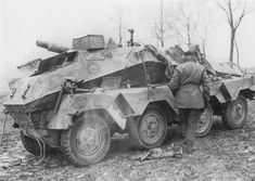 Sd.Kfz. 233. Armoured Car with 7.5 cm infantry gun. Note the low position in which this is placed unike other examples which uually have a larger superstructure. Also Window sliths in the style of SdKfz 251 and SdKfz 234.