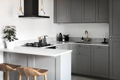 decordots: grey kitchen with breakfast bar. marble worktop and brass details