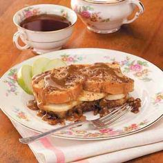 Apple-Stuffed French Toast Ingredients: 1 cup packed brown sugar 1/2 cup butter, cubed 2 tablespoons light corn syrup 1 cup chopped pecans 12 slices Italian bread (1/2 inch thick) 2 large tart apples,...