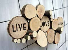 Live Love Laugh Abstract Wood Wall sculpture/ Wall hanging Have a space on your wall or in your home that you want filled with natural beauty? One of a Kind piece made from downed and dead trees and their branches. Re-purposed nature in the form of art for your home. Words are hand painted with acrylic paint. Ready to hang on your wall or display on a shelf or as a centerpiece for your table. Custom pieces available upon request. Color or stained options available a...