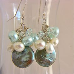 These teal pearl earrings are the perfect accessory for a beach or destination wedding or any special occasion. They are a mix of white and teal pearls and crystals. I selected different shapes and kinds of blue green and white pearls. The pearls include coin, teardrop shaped, and button shaped. Swarovski crystals add sparkle. I meticulously wire wrapped them with sterling and attached to sterling ear wires. I love coin pearls. I think they are among natures prettiest of pearls. Whenever…