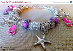 European Charm Bracelet Large Bead Silver Summer Bracelet by ClearWaterDesignsbyK, $20.97  Great Price Summer Sale!!!  All of the Beads in this Bracelet are Alloy European Large Beads , Silver coloured. They measure 7-10mm wide & 10-15 mm long.    This whimsical bracelet is perfect for Summer or a Beach Wedding.     Beach Themed Charms: Pink Flip Flop,Pink Purse, Star Fish with Middle East Rhinestones on the bail.  I can custom order for all your bridesmaids.