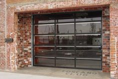 Garage door Clopay Avante, bronze anodized frame with clear glass. This Avante garage door is used as a store front. People love this look an feel when you can open the wall and get fresh air.