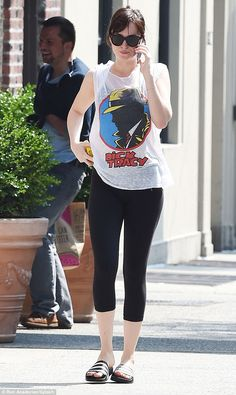Casual:With her dark brown locks tied back, Dakota showed off her natural beauty with minimal make-up