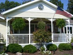 Durabrac Gingerbread proudly made in the USA. The Bienville vinyl bracket mimics the wave of the flag on this pretty porch. Porch Brackets, Gingerbread, Columns, Pretty, Outdoor Decor, Wave, Flag, Country, Dress