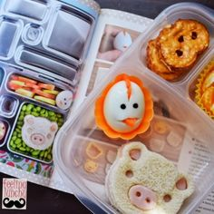 Turkey and cheese on Italian white bread with an egg adorned with carrots, an orange with raisins and some pretzel thins -- inspired by Everyday Bento