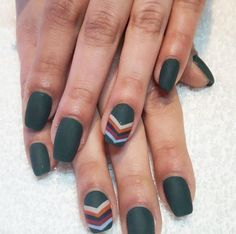 Channel the '70s with a cool ivy-green manicure complemented by a funky multicolored chevron accent nail. See more on Victoria Park's Instagram »