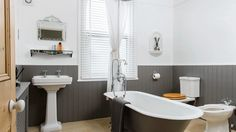 Traditional Bathroom with Grey Roll-top bath and Painted Panelling
