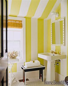 A Striped Bathroom:   Designer Leslie Klotz used paint to create big, bold stripes in this Hamptons bathroom: Apple Green and Decorator's White, both by Benjamin Moore.
