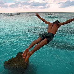 Cliff Diving from the rocks between White Beach and Diniwid Beach. Boracay, Philippines