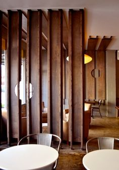 Modern Interior Design in Seattle - New wood screens separate a private seating area from the rest of the cafe. The construction of the wood paneling is visible from the entry to the cafe.  (Cafe Javasti by Paul Michael Davis Design) www.paulmichaeldavis.com