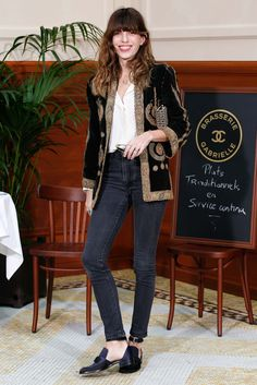 Lou Doillon in skinny jeans, cutout shoes, embroidered blazer.