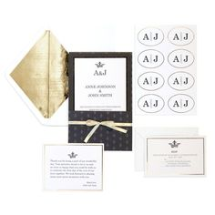<div>This black and gold invitation suite has a crown and fleur de lis decorations on three card...