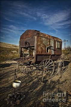 A retired sheepherder's wagon rests among other relics at the ghost town of Shakespeare, New Mexico.