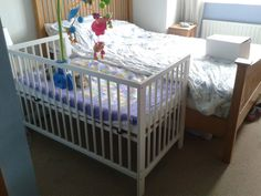 Converting an ikea cot to a bedside cot.