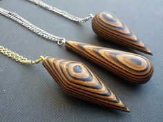 Since mid 2012 I have been working on a range of hand-turned wooden pendants and earrings at my workshop. Each piece consists of dozens of thin layers of timber veneer. I use a range of veneers, some. Driftwood Jewelry, Wooden Jewelry, Resin Jewelry, Jewelry Crafts, Wooden Necklace, Wooden Earrings, Dremel Wood Carving, Laser Cut Jewelry, Wood Resin