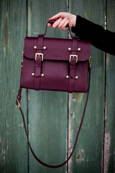 Loving this color this season. I love multiple straps on purses like this, so I can carry it in my hand or sling it over my shoulder if I wish.