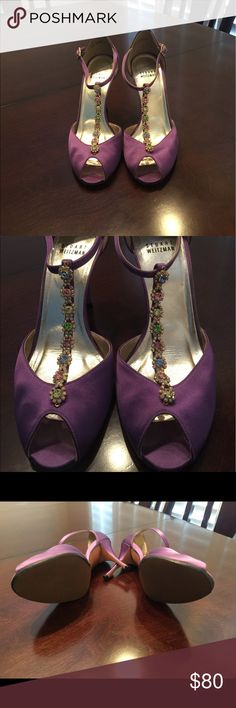 Stuart Weitzman Fabulosity Plum Satin size 7 Beautiful purple peep toe heels with gorgeous multi color jewels that sit on the front. Had the bottoms redone as they were a little scuffed but otherwise in really great shape. Paid $360 for these and never wear them. Bought them for a wedding years ago and hoping someone can get some use out of them! Stuart Weitzman Shoes Heels