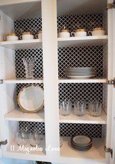 Jazz up plain glass cabinets with shelf paper on back wall from 11 Magnolia Lane.