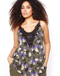 Choose a simple plus size tank top that features the cool details that will make it an essential piece of  your collection. Flattering swing shape, V-shaped crochet appliqué at the neckline, cool print, 28 inch length, Michel Studio.