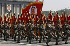 Soldiers carried an image of North Korea's founder, Kim Il Sung.
