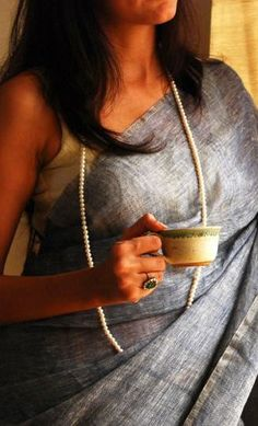 Notes: 1) A plain Khadi saree in a neutral shade 2) Large colorful ring 3) Long Pearl Necklace