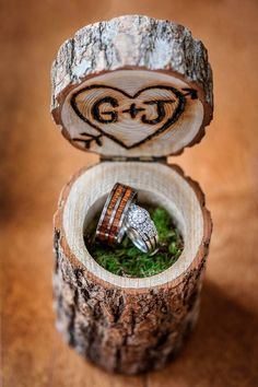woodburnt stump ring box filled with moss