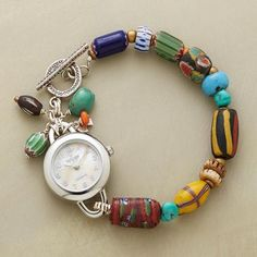 Designed by Peyote Bird Designs | Vintage African trade beads, turquoise, sterling silver and watch face | 168$