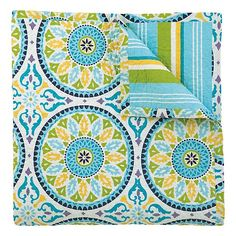 Our Lisette quilt features a refreshing pool of blues, purples, greens with accents of sunny yellow.