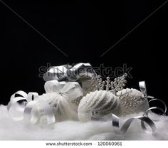 stock-photo-white-christmas-balls-gift-snowflake-still-life-on-black-background-120060961.jpg (450×398)