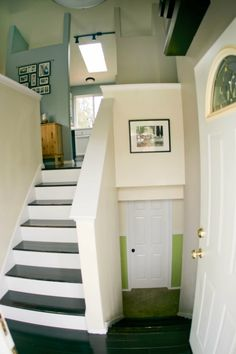 Split level entry - this is just like our house. I love the stairs and the caps on top of the partial walls.