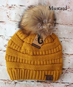 A little twist on the popular CC beanie hats - a faux fur pom pom on top! Available in 20 fabulous colors - the perfect winter accessory! 100% Acrylic, one size fits most. Also available without the f