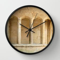 """""""Windows Of Stone""""Available in natural wood, black or white frames, $30.00 - our 10"""" diameter unique Wall Clocks feature a high-impact plexiglass crystal face and a backside hook for easy hanging. Choose black or white hands to match your wall clock frame and art design choice. Clock sits 1.75"""" deep and requires 1 AA battery (not included). #clock #wall #windows #homedecor #stone #ancient"""