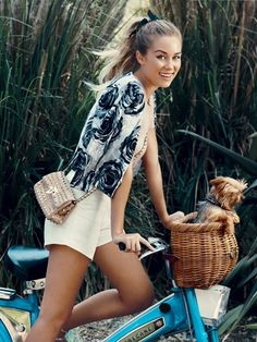 OMG this will be me!  Once I get my first house, Im getting a puppy and a bike with a basket.  Cant wait for those summer rides with my pup : )