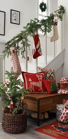 So quaint and classic! Love the stockings and garland combination down the stairs, especially for those without a mantle!