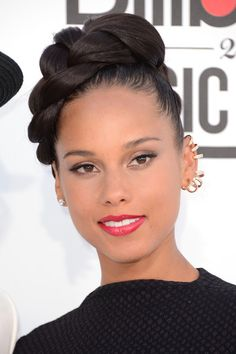 Alicia Keys Braided Updo -   Alicia Keys wore her hair styled in a large glossy braid for the 2012 Billboard Music Awards.