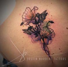Justin Nordine flower tattoo