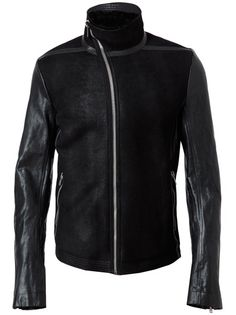 Black suede jacket with leather arms and shearling lining from Rick Owens. Stand up collar leads into an asymmetric zip down front. Long sleeve with concealed zip cuffs. Two front zip pockets. Leather seam detail. Full lined. Specialist dry clean only.