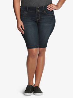 Oh-so-comfortable. Oh-so-sexy. Once you get into our Bermuda jegging shorts - you'll never want to take them off. A three-button higher rise waist and faux front pockets create a sleek, streamlined shape. In a dark wash with subtle whiskering, meet your new favorite jean short.