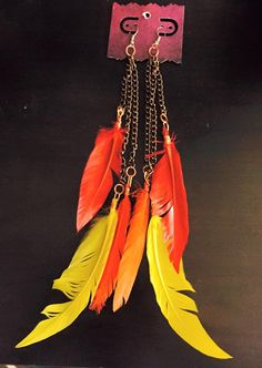 aaseagypsy jewels; fire at the festival feather earrings;