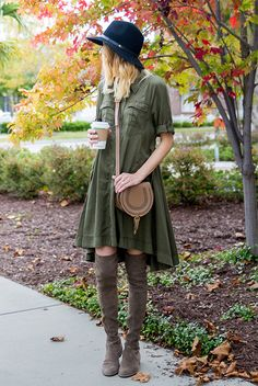 fall / winter - street style - street chic style - casual outfits - military dress + black fedora + nude shoulder bag + light brown over the knee boots