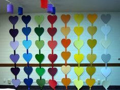 "Cinderblocks covered with ""love""...value colored paper hearts glued on grosgrain ribbon and hung with drapery hook and command strips."